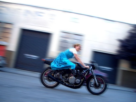 Jennifer Bromme races her classic Rickman motorcycle down Capp Street